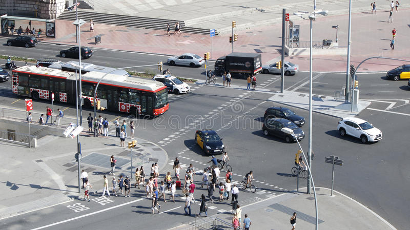 Cars and people in Barcelona. Barcelona traffic, cars, buses and pedestrians on a sunny day, Spain, July 2016 stock image