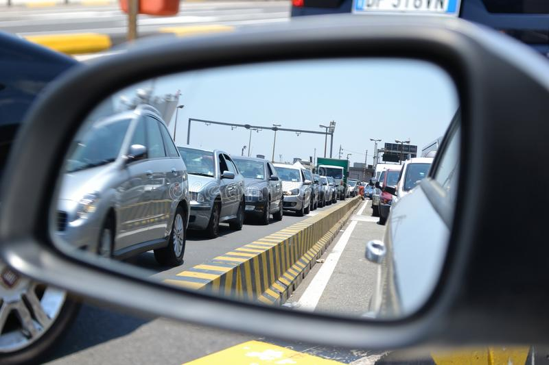 Cars queue. Seen from the rearview mirror of the car
