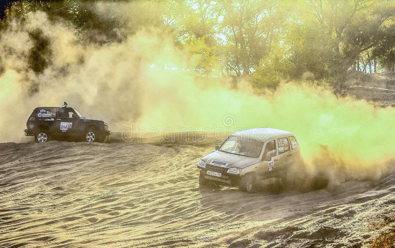 2 cars on the race in the dust royalty free stock photography