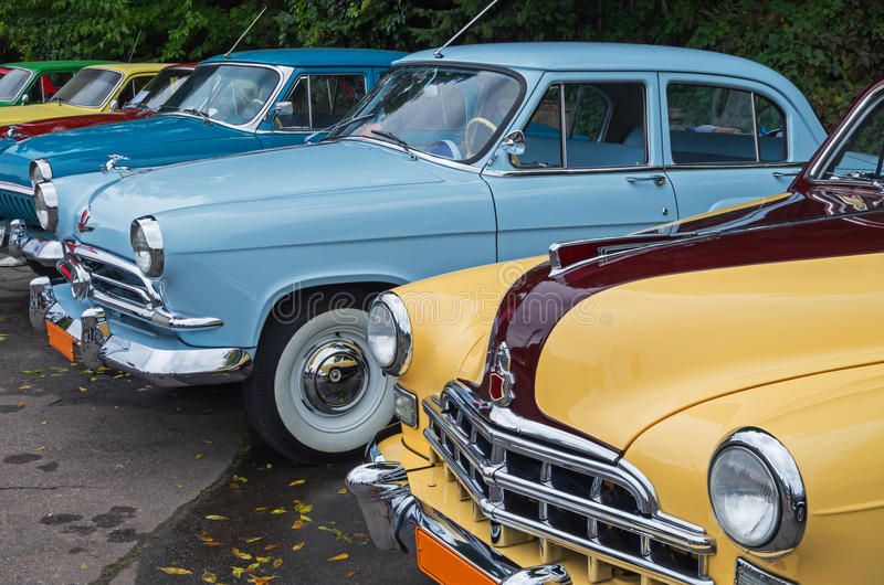 Cars retro. Vintage vehicles are in the parking lot on the city show stock photography