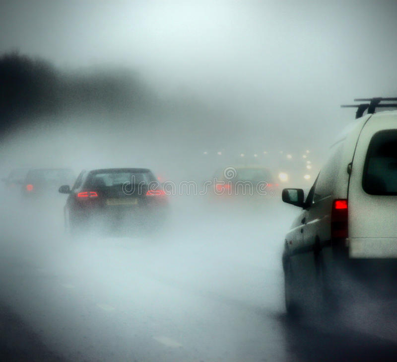 Download Cars On A Road In Heavy Rain And Fog Stock Photo - Image: 12226016