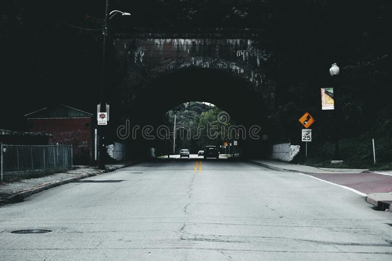 Cars on Road Under Tunnel during Daytime royalty free stock photo
