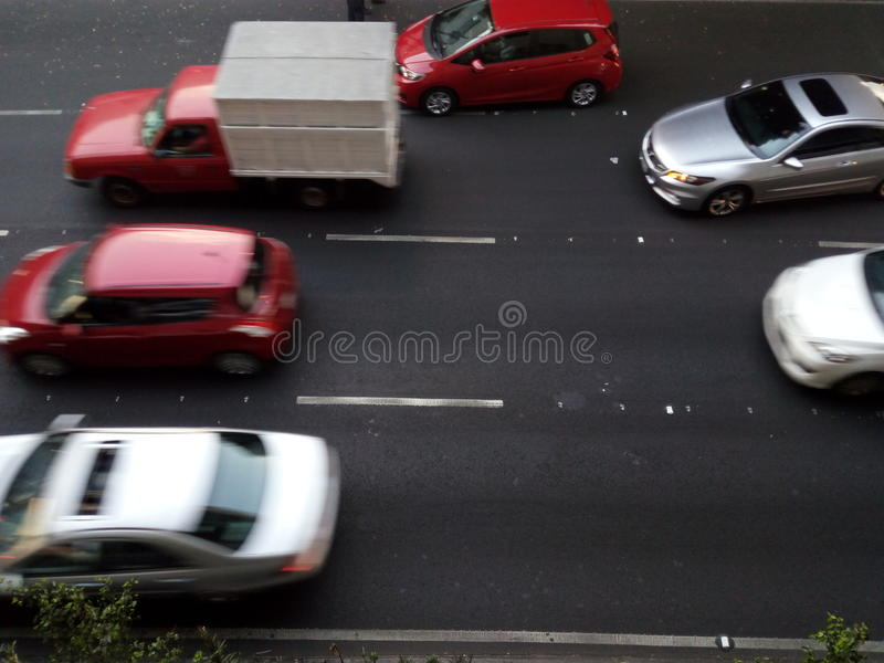 Cars running in Mexico Street avenue. Cars Runnning in Tlalpan Avenue in Mexico City streets. Automotive transport in cities royalty free stock photo