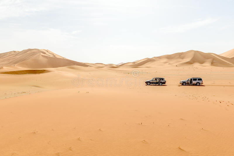 Cars among sand dunes in Oman desert (Oman). Cars among sand dunes in Rub al-Khali desert, Dhofar region (Oman stock images