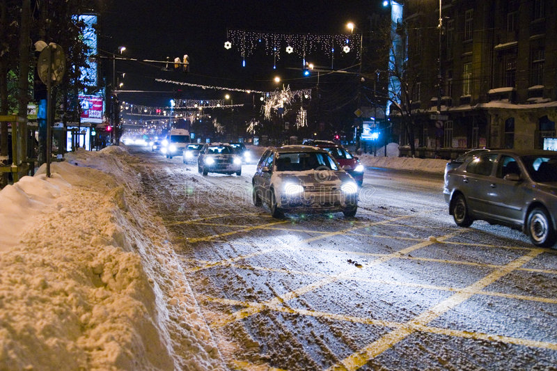 Cars on snowy road in Bucharest royalty free stock images