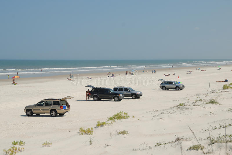 Cars on St Augustine beach. Scenic view of parked cars and people on St. Augustine beach, Florida, U.S.A stock photography