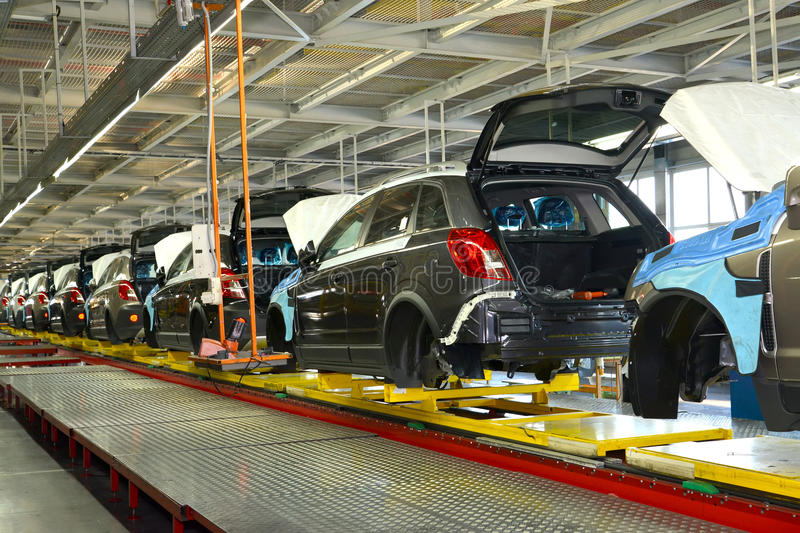 Cars stand on the conveyor line of assembly shop. Automobile pro royalty free stock image