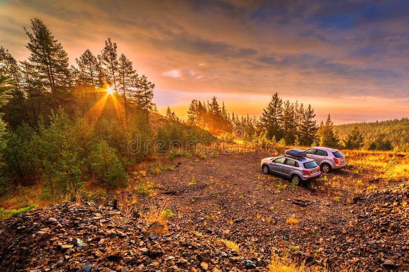 Autotourism in the Ural Mountains. Cars standing in a quarry at dawn. Autotourism in the Ural Mountains royalty free stock image