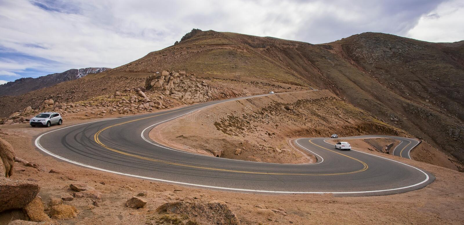 Cars on the steep, winding road up Pikes Peak, Colorado stock photo