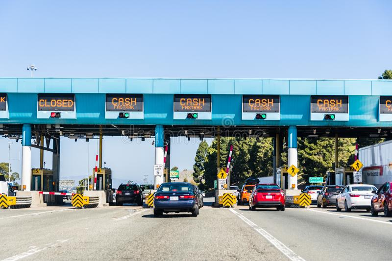 Cars stopping at the Toll Plaza to pay for the use of the bridge, Vallejo. April 14, 2018 Vallejo / CA / USA - Cars stopping at Carquinez Bridge Toll Plaza to stock images
