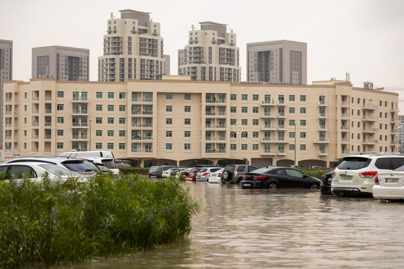 DUBAI, UAE - CIRCA 2020: Cars stuck in water in a flooded parking lot after heavy in rain in Dubai royalty free stock images