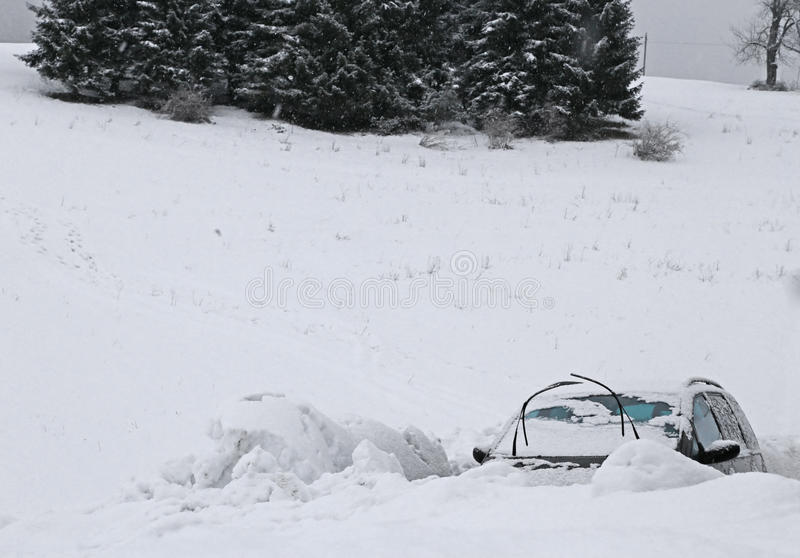Cars submerged in snow after the snowstorm. In the mountains in winter stock photo