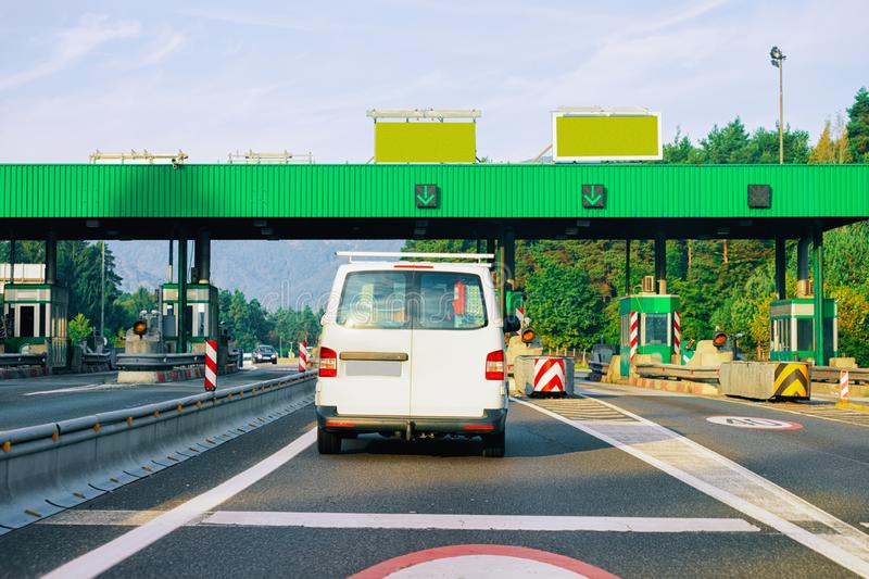 Cars at Toll booth with Blank signs in road in Slovenia royalty free stock photo