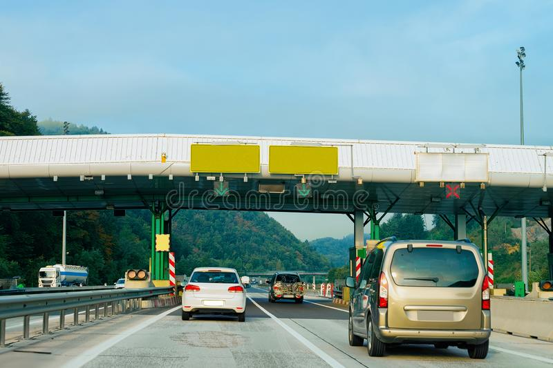Cars in Toll booth with Blank signs on the road Slovenia stock photo