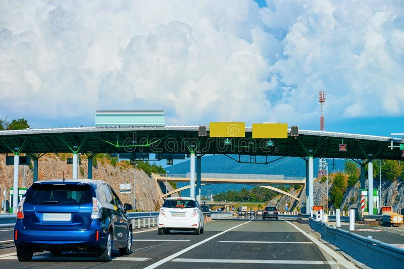 Cars at Toll booth with Blank signs on road in Slovenia stock images