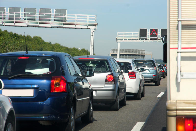 Cars in traffic jam on highway royalty free stock photography