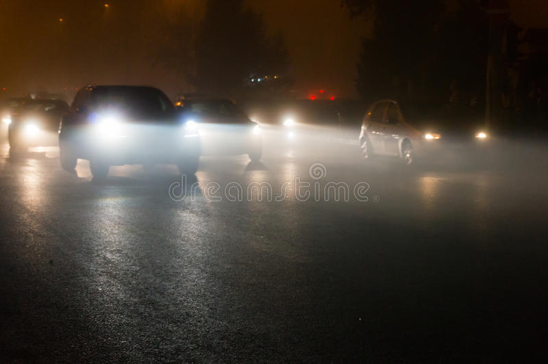 Cars in traffic at night royalty free stock photos