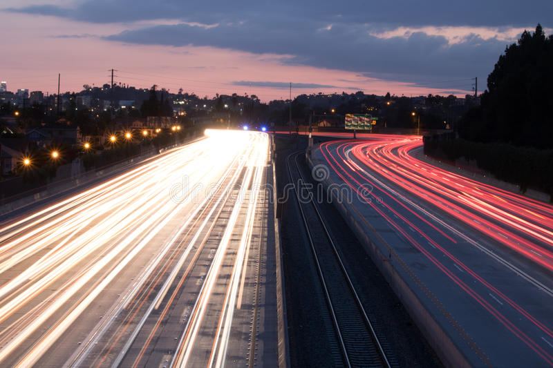 Cars traveling down the freeway stock photos