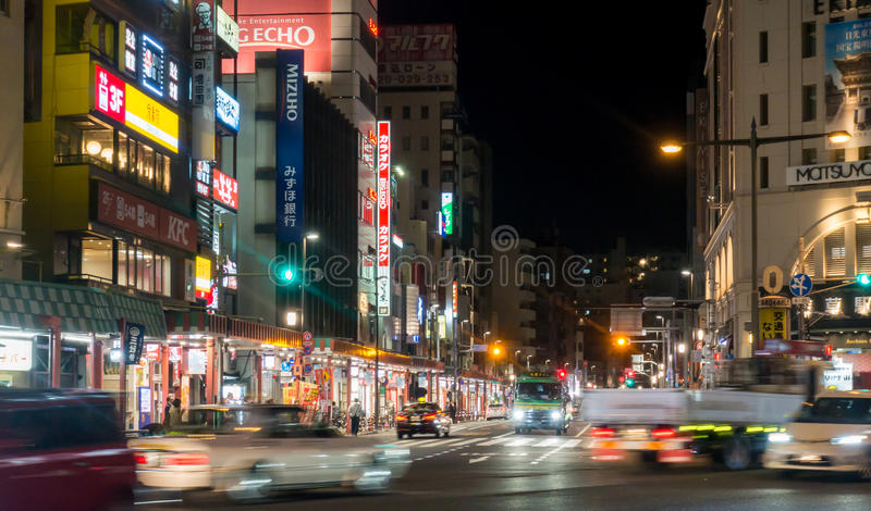 Cars are traveling fast in Asakusa intersection. Tokyo, Japan - May 2, 2017: Cars are traveling fast in Asakusa intersection royalty free stock photos