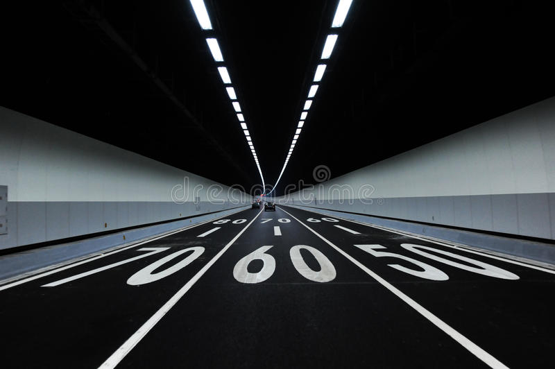 Cars in tunnel stock photography