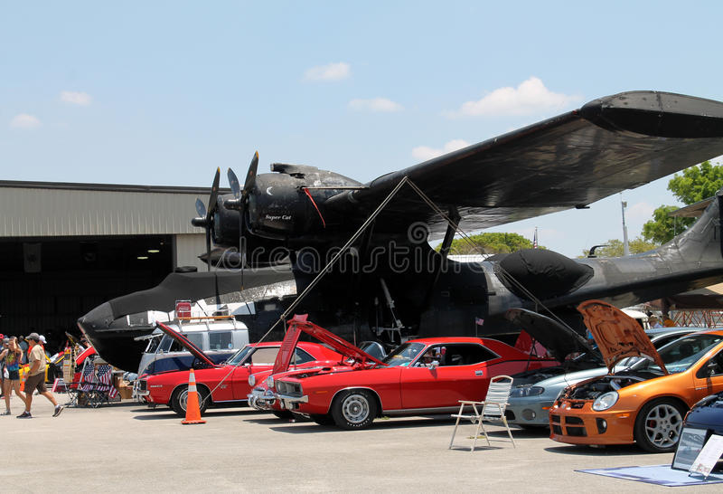 cars under airplane wing editorial stock photo image ForWing Motors Automobiles Miami Fl