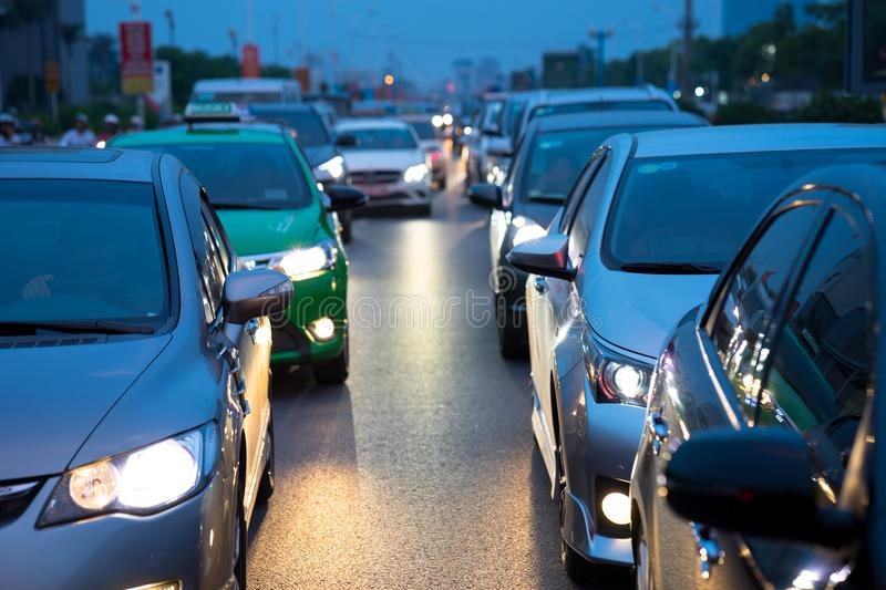 Cars on urban street in traffic jam at twilight.  royalty free stock photos