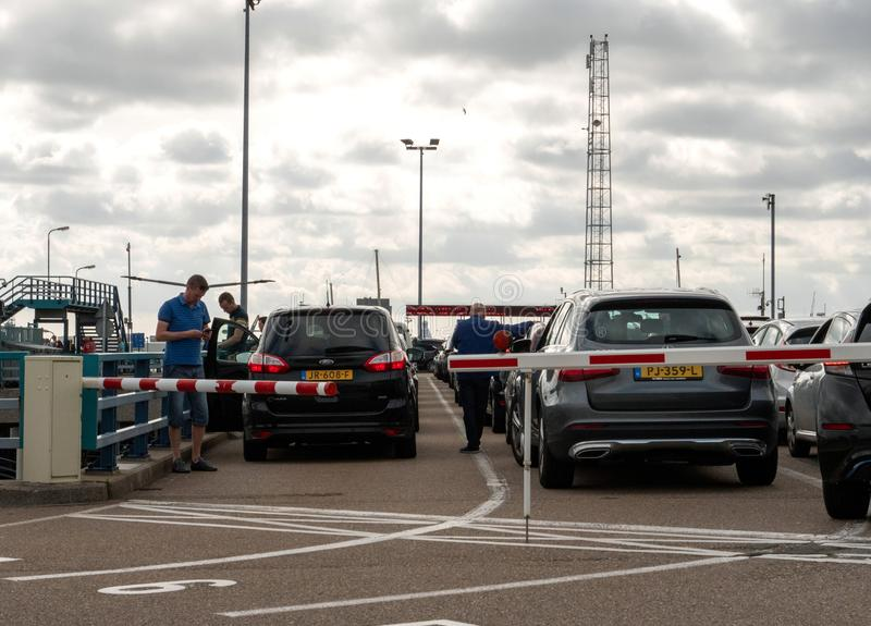 Cars waiting for the boarding on ferry boat stock images