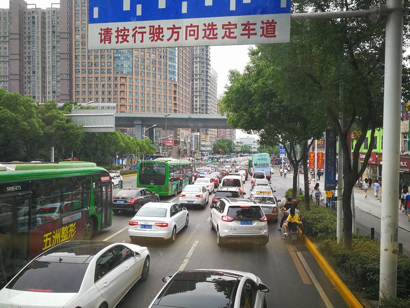 Cars waiting for traffic lights. Cars stop on the crossroads, waiting for the traffic lights, in wuhan city, hubei province, china stock photo