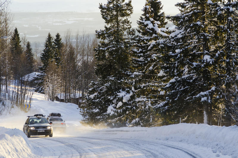 Cars on winter road Sweden. Cars on snowy winter road in Are (Swedish: Åre), Jamtland (Swedish: Jämtland) county, Sweden stock image