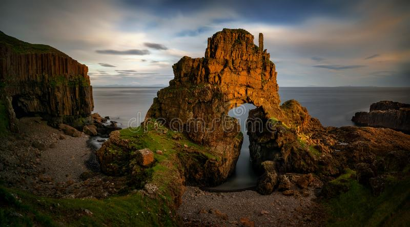 Carsaig Arches Mull. Carsaig Arches - rocks formation in sunset light, Isle of Mull, Scotland stock images