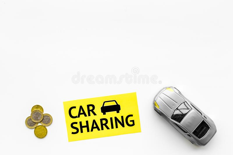 Carsharing concept. Toy car near text car sharing on white background top view copy space. Carsharing concept. Toy car near text car sharing on white background stock photos