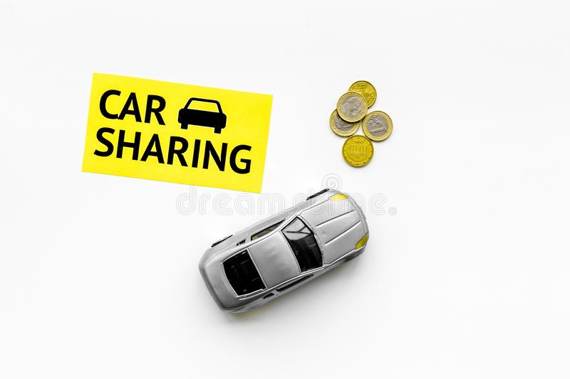 Carsharing concept. Toy car near text car sharing on white background top view copy space. Carsharing concept. Toy car near text car sharing on white background royalty free stock images