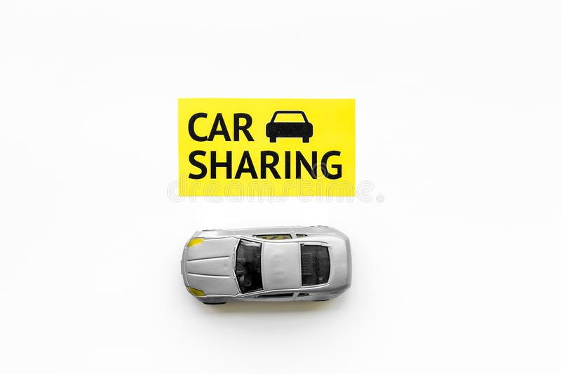 Carsharing concept. Toy car near text car sharing on white background top view space for text. Carsharing concept. Toy car near text car sharing on white royalty free stock photography