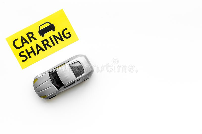 Carsharing concept. Toy car near text car sharing on white background top view space for text. Carsharing concept. Toy car near text car sharing on white royalty free stock image