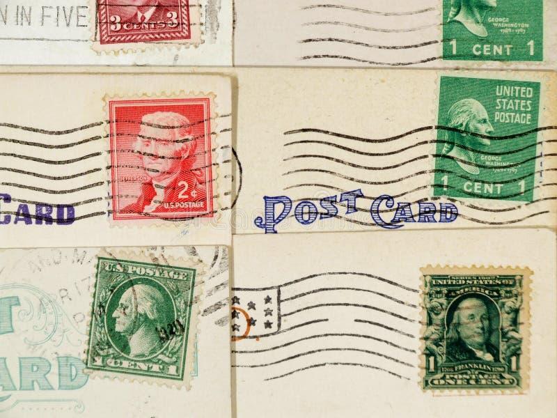 Cartão antigos e selos cancelados fotografia de stock
