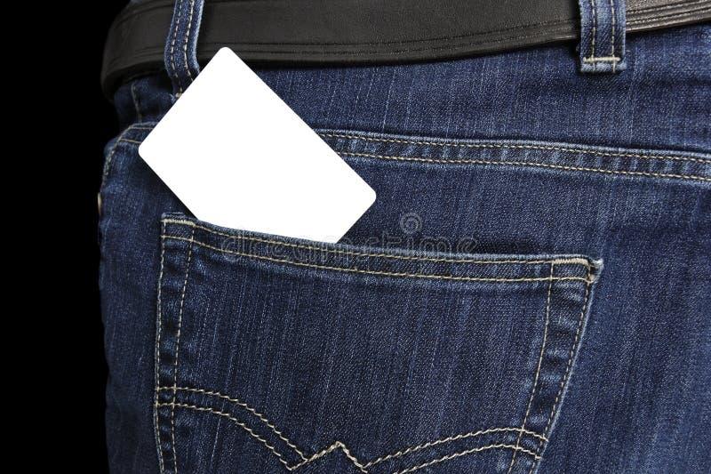 Cartão branco no bolso das calças de brim imagem de stock