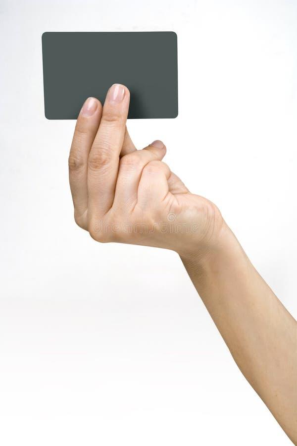Cartão da mão e de crédito imagem de stock