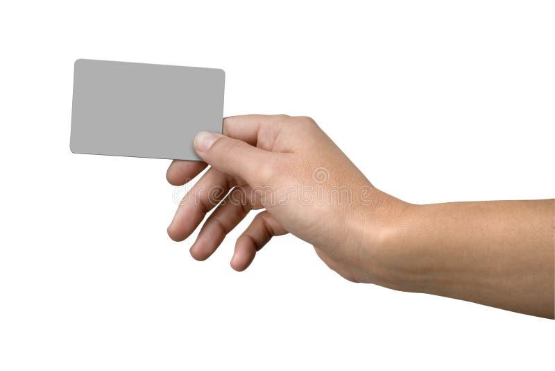 Cartão da mão e de crédito em branco fotos de stock royalty free