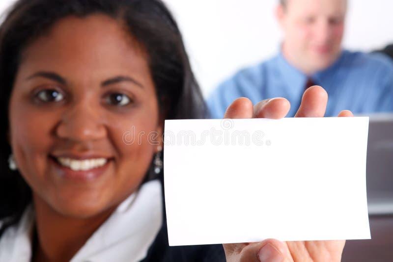 Cartão da terra arrendada da mulher imagem de stock royalty free