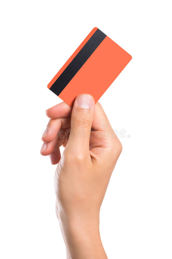 Cartão de crédito da terra arrendada da mão fotografia de stock