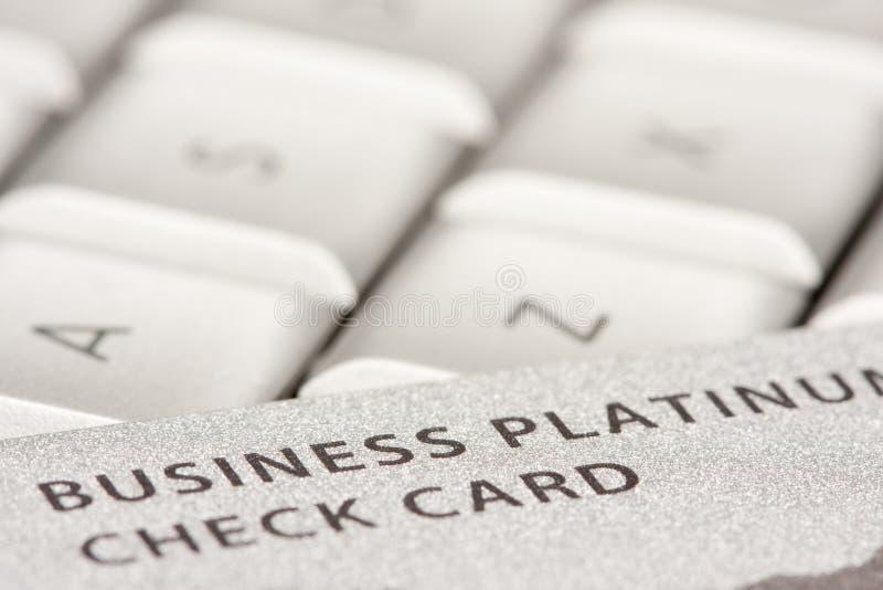 Cartão de crédito do negócio no portátil fotografia de stock