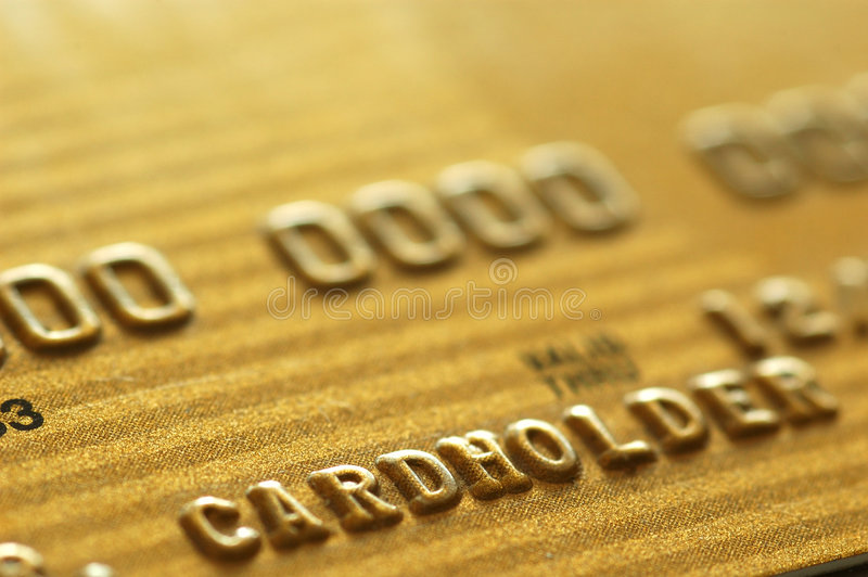 Cartão de crédito do ouro imagens de stock royalty free
