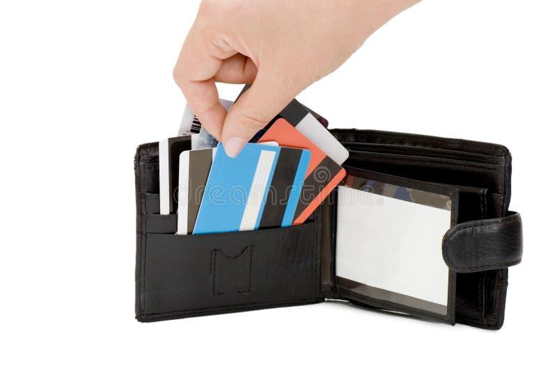 Cartão de crédito em uma bolsa fotos de stock