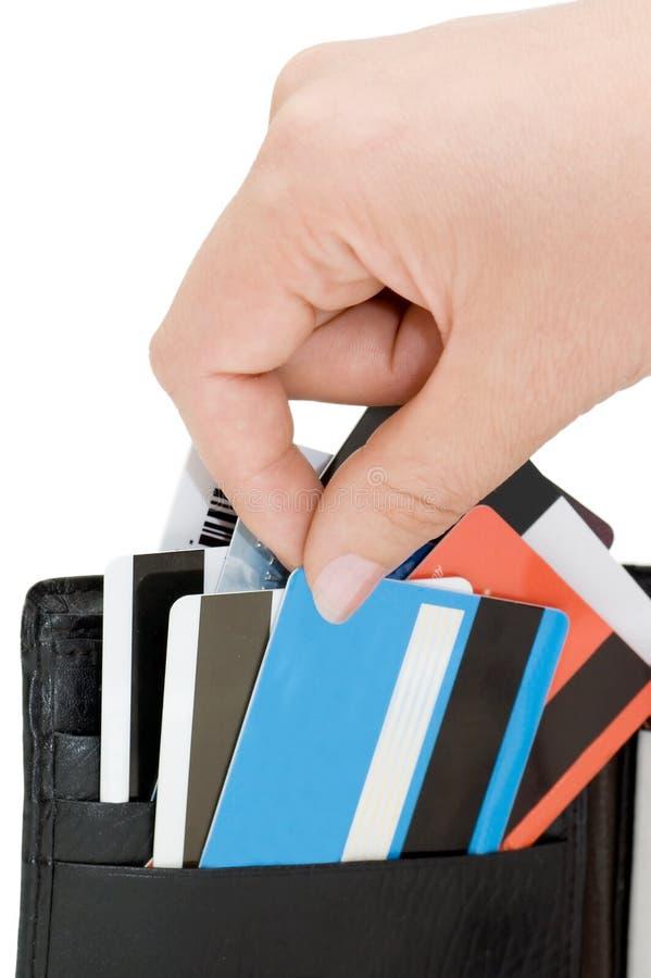 Cartão de crédito em uma bolsa imagens de stock royalty free