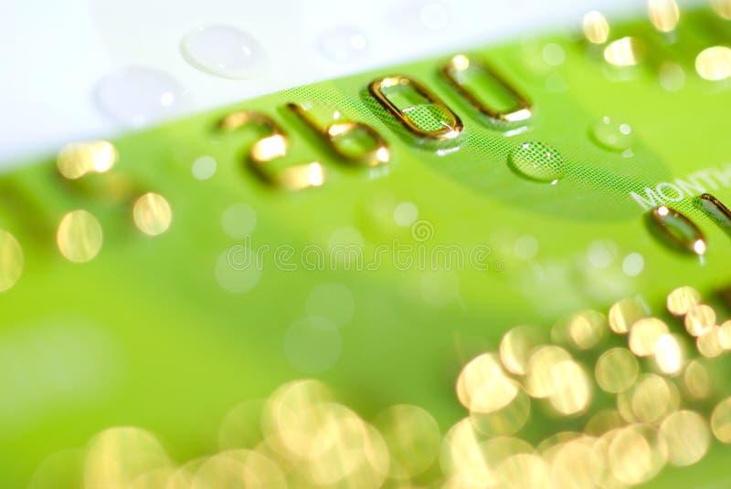 Cartão de crédito molhado imagem de stock