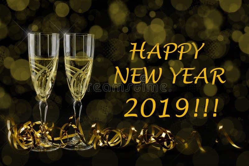 Cartão de cumprimentos do ano novo 2019 Bokeh e efeitos brilhantes no fundo preto fotos de stock