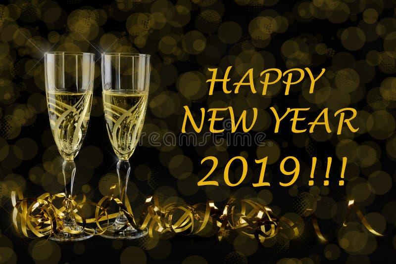 Cartão de cumprimentos do ano novo 2019 Bokeh e efeitos brilhantes no fundo preto foto de stock royalty free