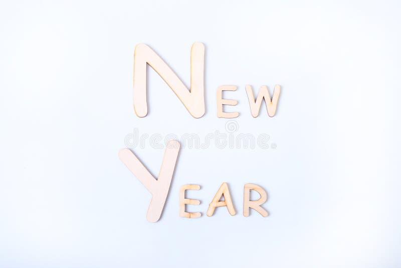 Cartão de cumprimentos do feriado do ano novo na tabela da placa branca fotos de stock