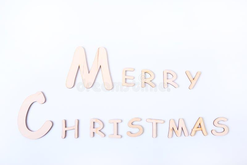 Cartão de cumprimentos do feriado do Feliz Natal na tabela da placa branca foto de stock royalty free