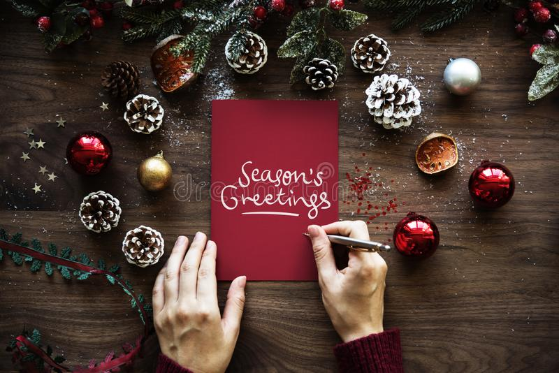 Cartão de cumprimentos temático do ` s da estação do Natal imagens de stock royalty free